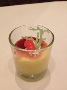 Mango mousse topped with a sprig of seaweed