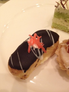 Chocolate eclair topped with pink seaweed